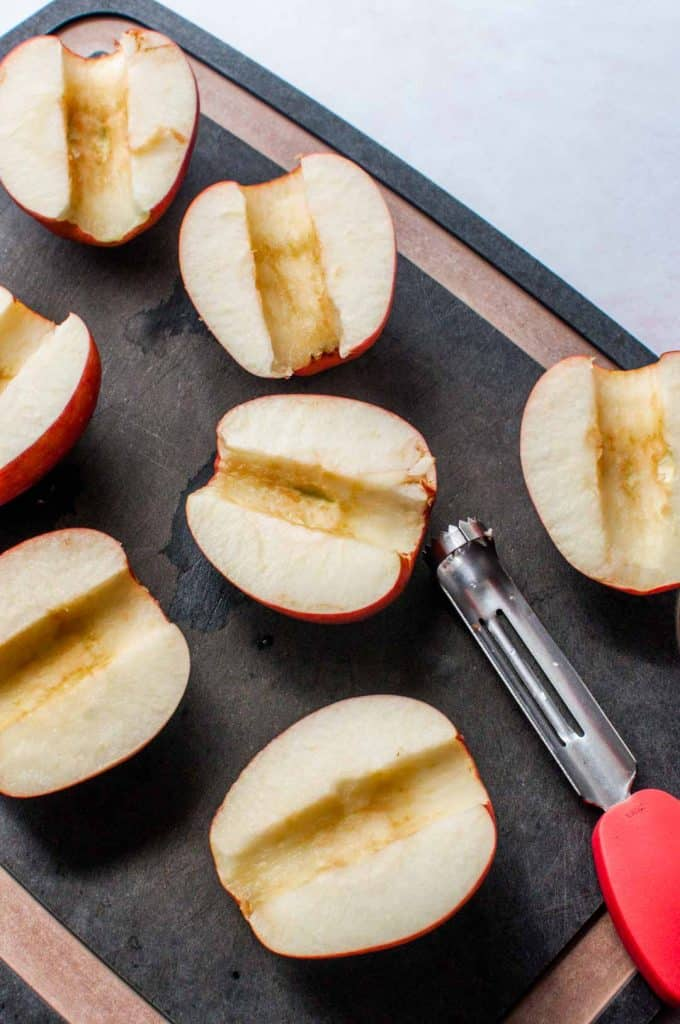 cored apples on a cutting board