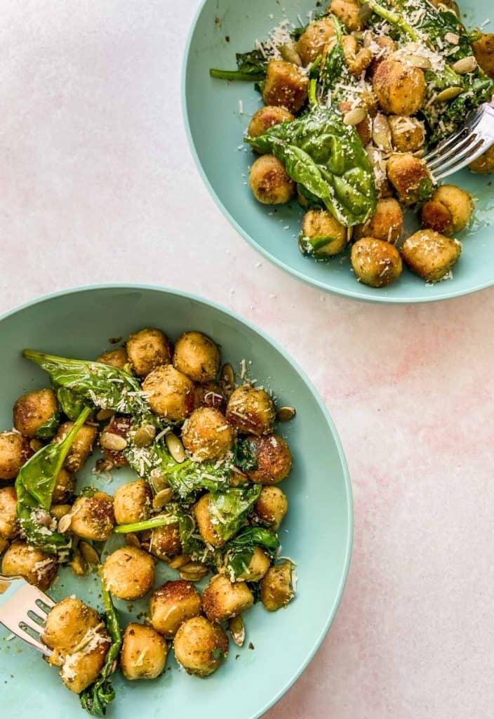 two bowls of cauliflower gnocchi with pesto