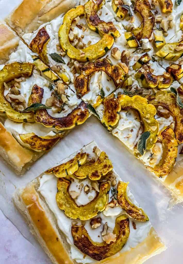delicata squash tart with a piece cut out of it