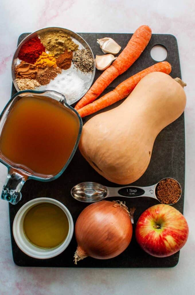 butternut squash soup ingredients on a cutting board