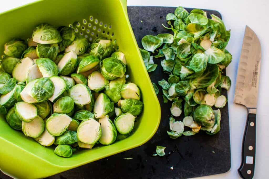 cut brussels sprouts on a cutting board with a knife