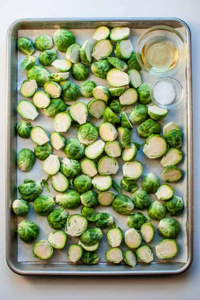 brussels sprouts, olive oil, and salt on a baking sheet