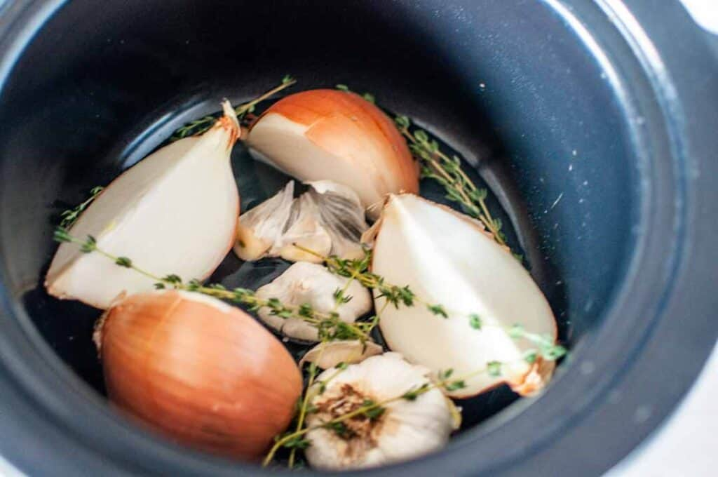 garlic and onions in a slow cooker