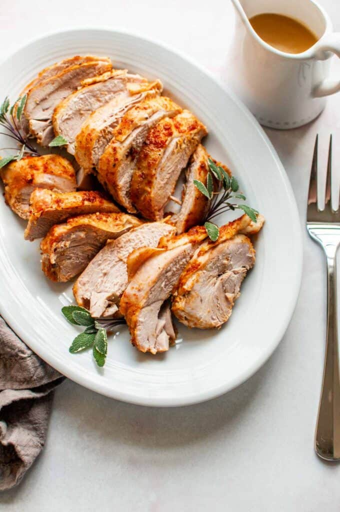 turkey breast slices on a platter with gravy