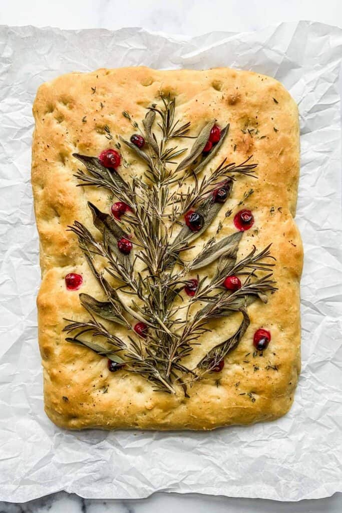 decorated focaccia on a piece of parchment