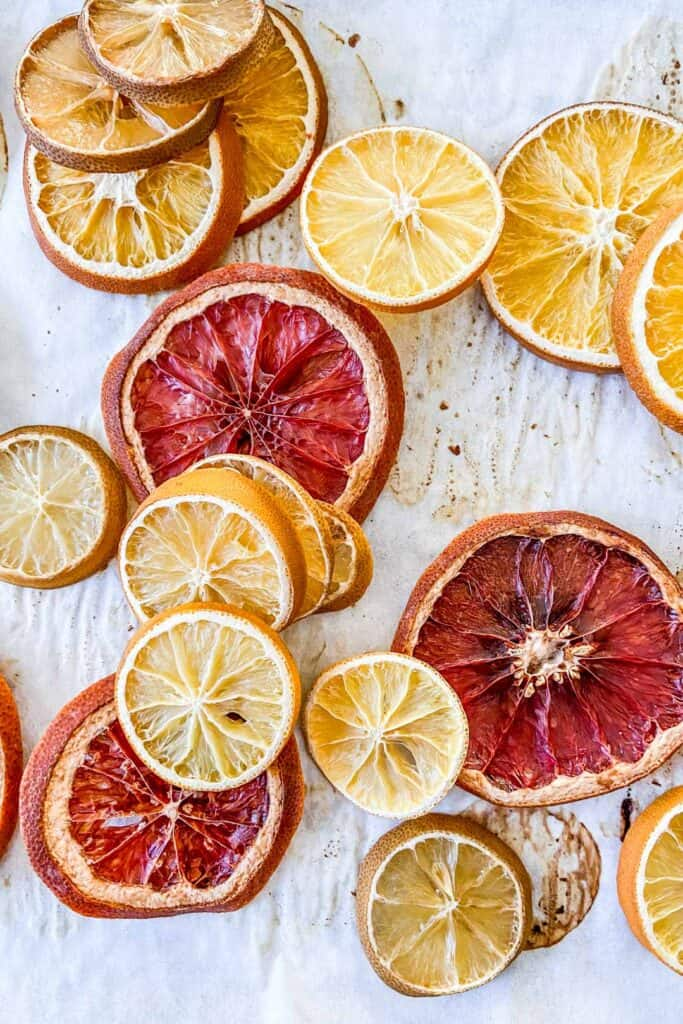 dried orange slices on a piece of parchment