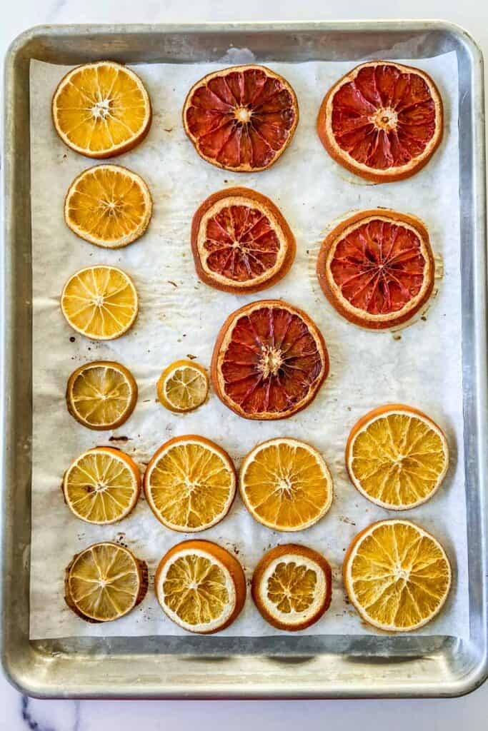 dried citrus slices on a baking sheet