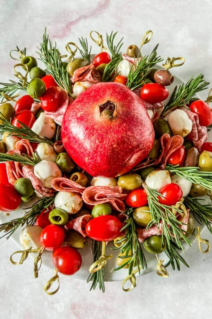antipasto wreath with a pomegranate in the center