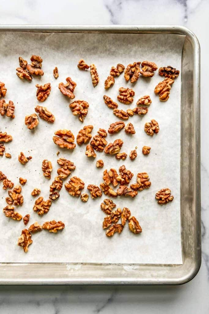 toasted walnuts on a baking sheet
