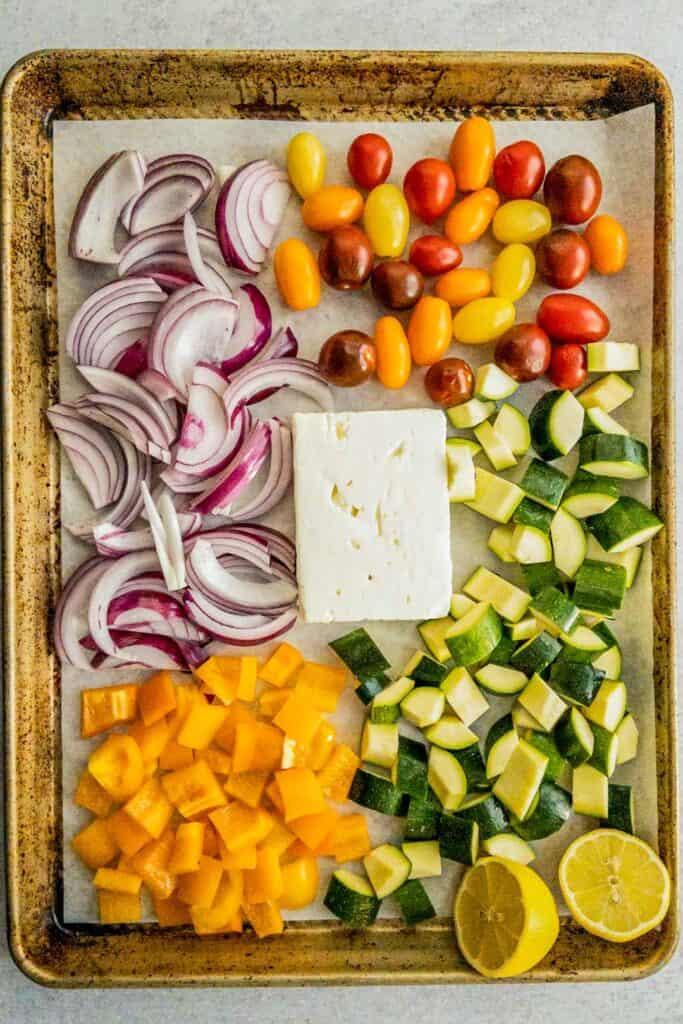 roasting feta and vegetables on a baking sheet