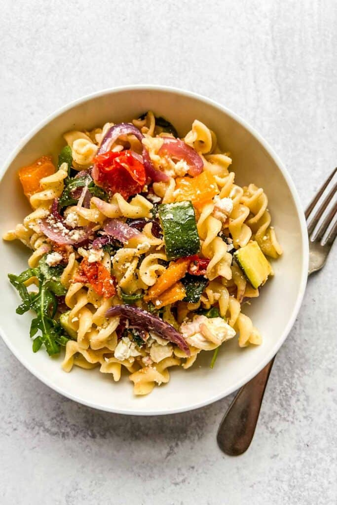 veggie pasta in a bowl with a fork