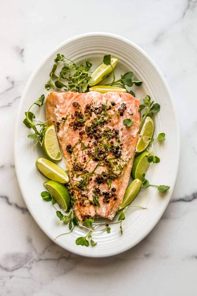 salmon with juniper berries and lime on a large serving plate