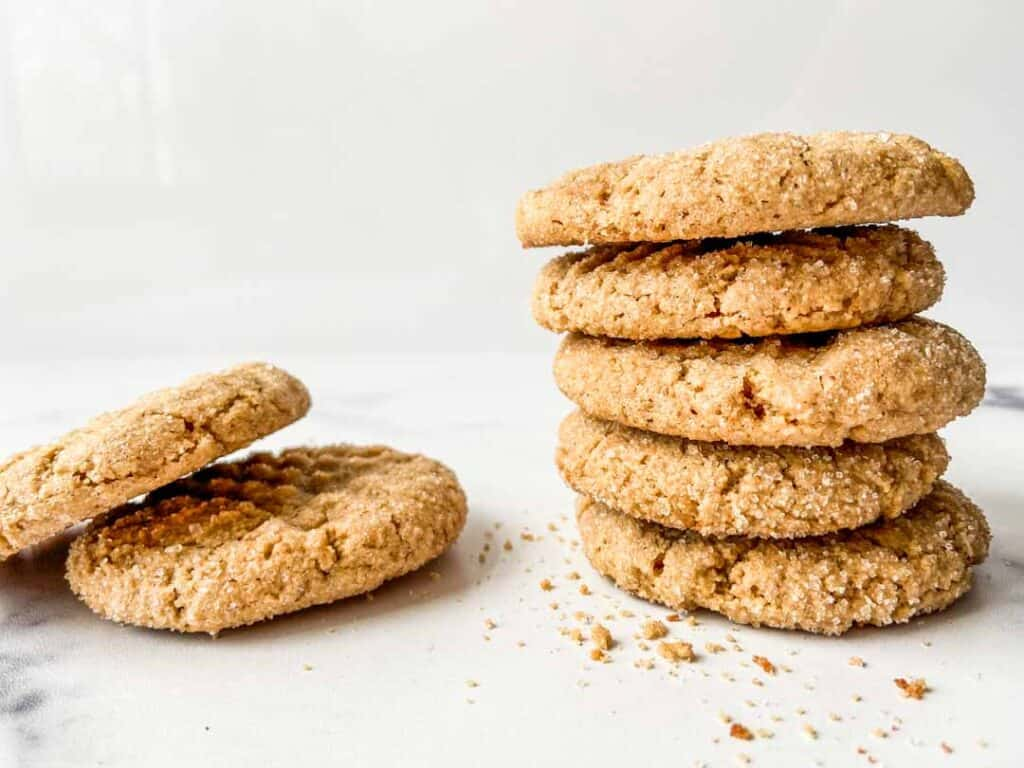 Peanut butter cookies in a stack.