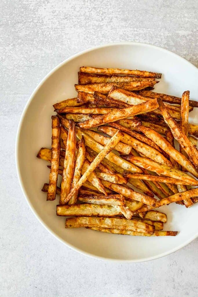 Togarashi fries in a white serving bowl.