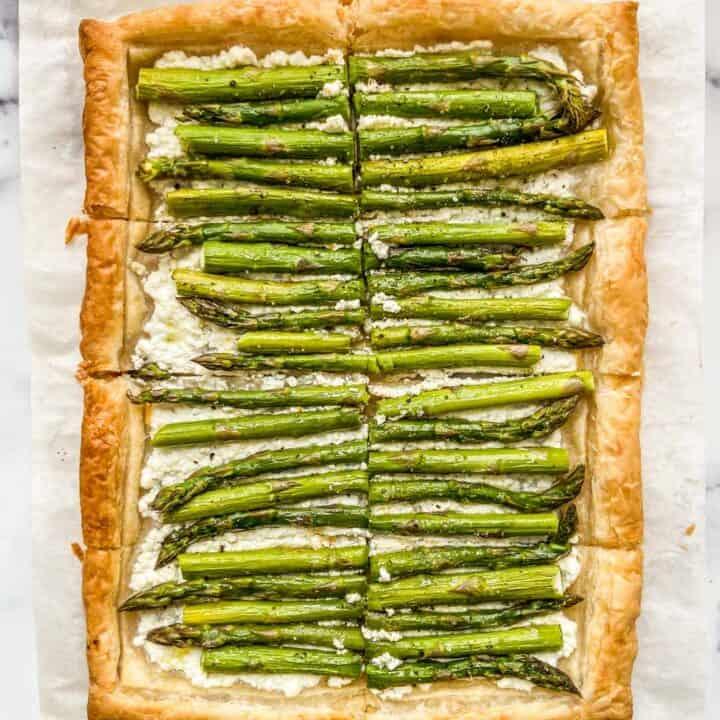 An asparagus tart on a piece of parchment paper.