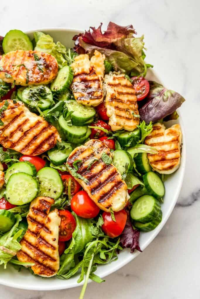 Close up shot of a grilled halloumi salad.
