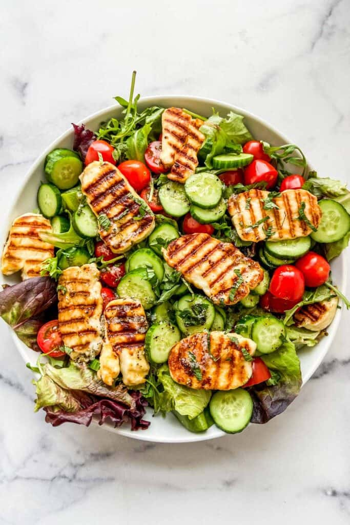 Overhead shot of grilled halloumi salad.