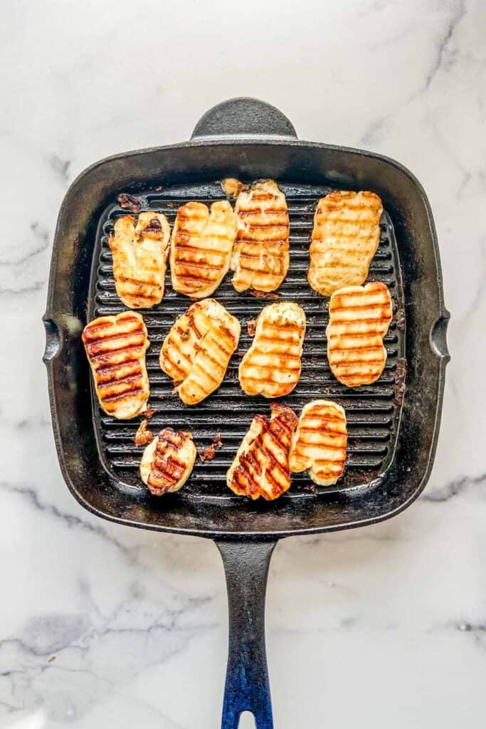 Grilled halloumi in a grill pan.