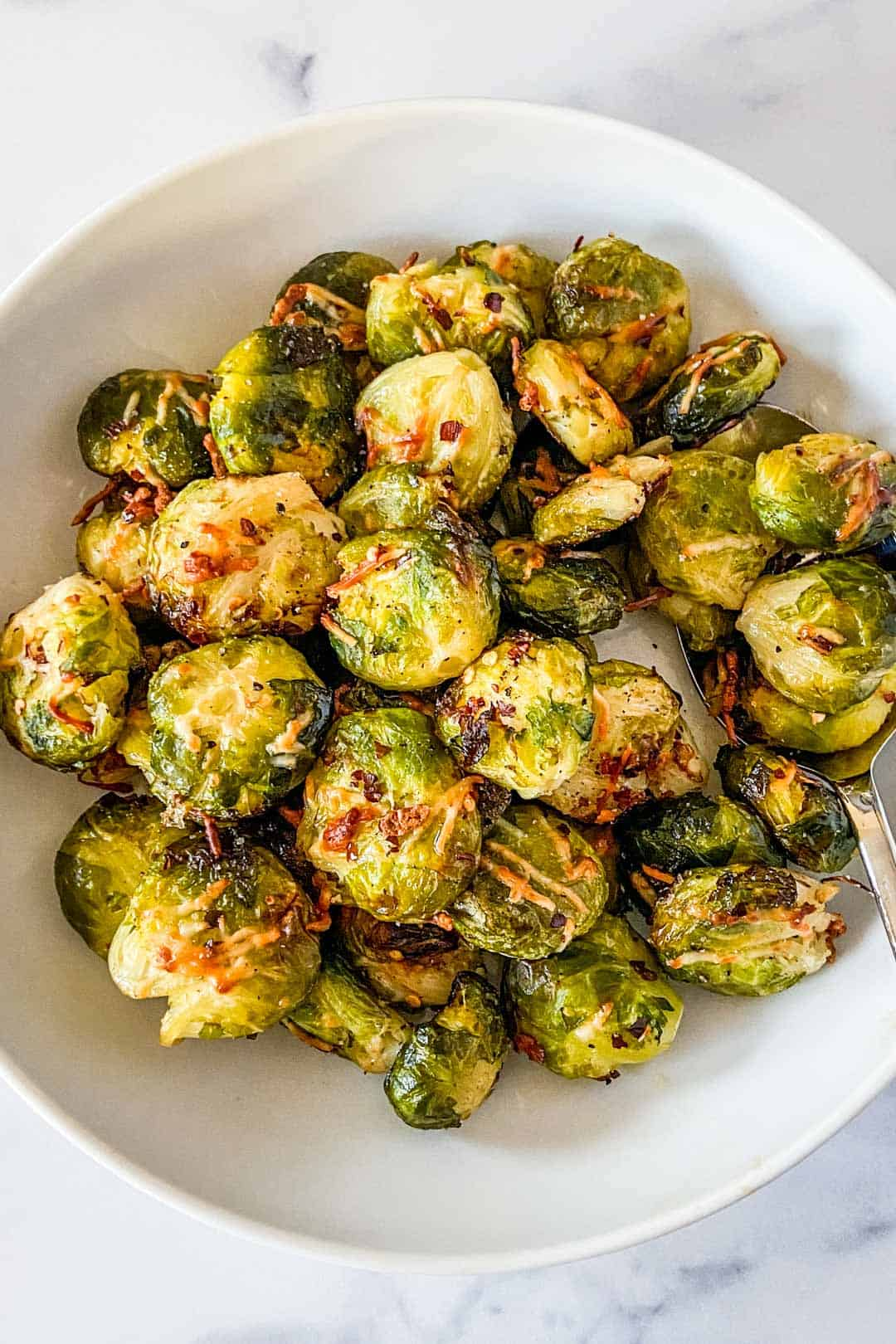 Crispy smashed Brussels sprouts in a serving bowl.