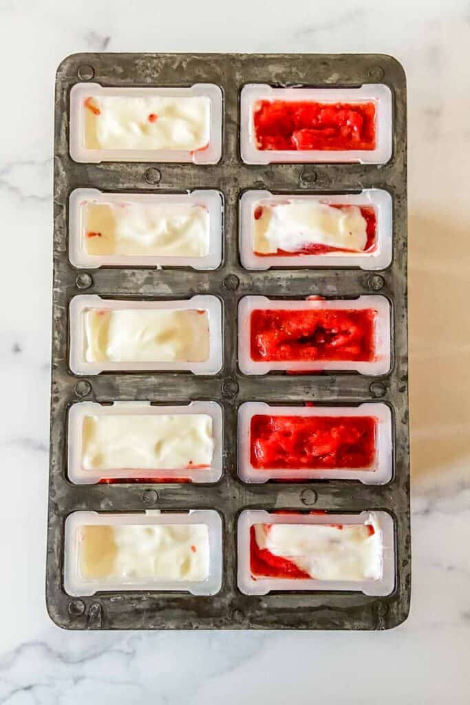 Strawberry Yogurt popsicles before going in the freezer.
