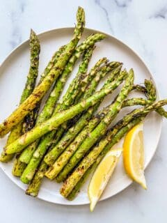 An overhead shot of a plate of grilled asparagus.