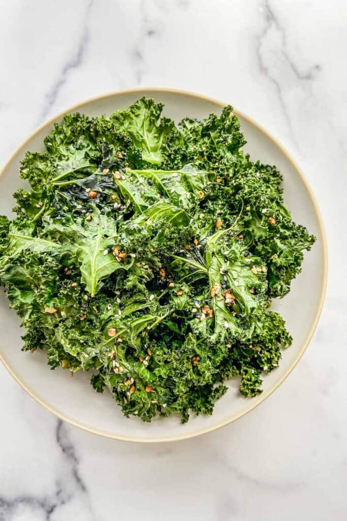 An overhead shot of a serving bowl filled with kale chips.