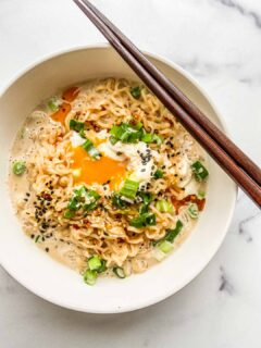 A bowl of milk ramen with a poached egg.