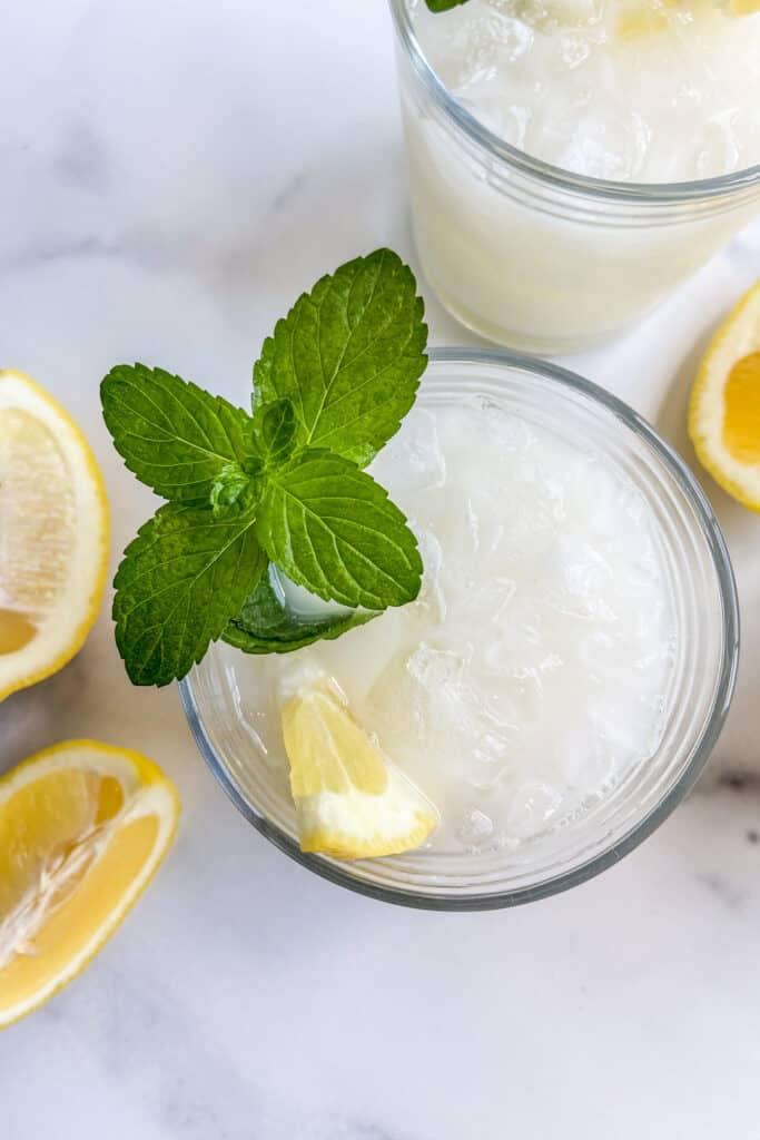 A closeup of a glass of creamy lemonade.
