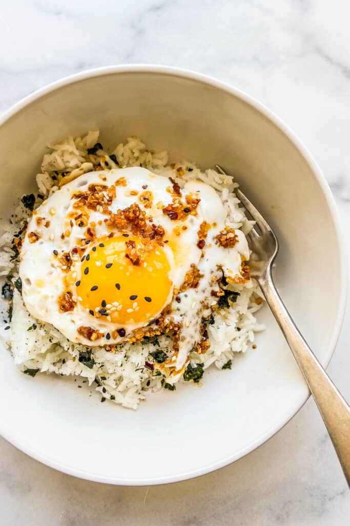 A bowl of chili oil eggs served over rice and furikake.