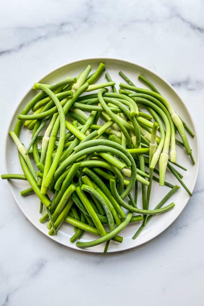 A plate of chopped garlic scapes.