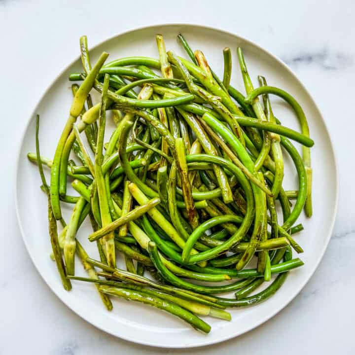 A plate of sautéed garlic scapes.