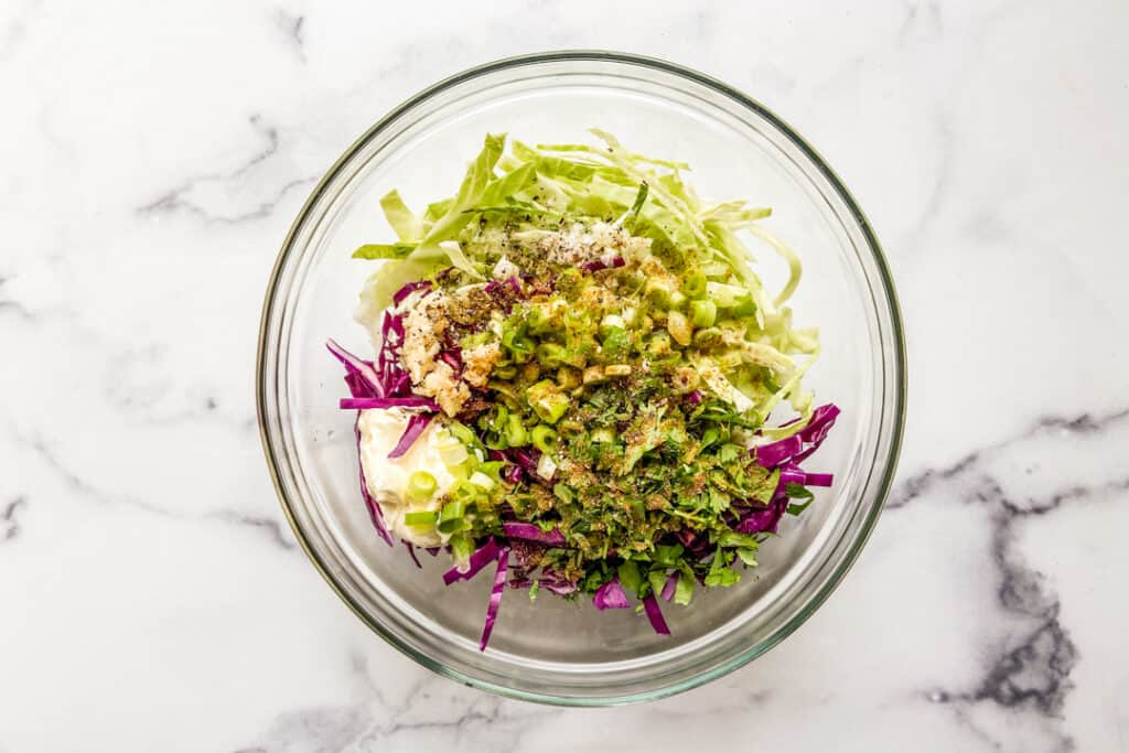 A mixing bowl with slaw for fish tacos.