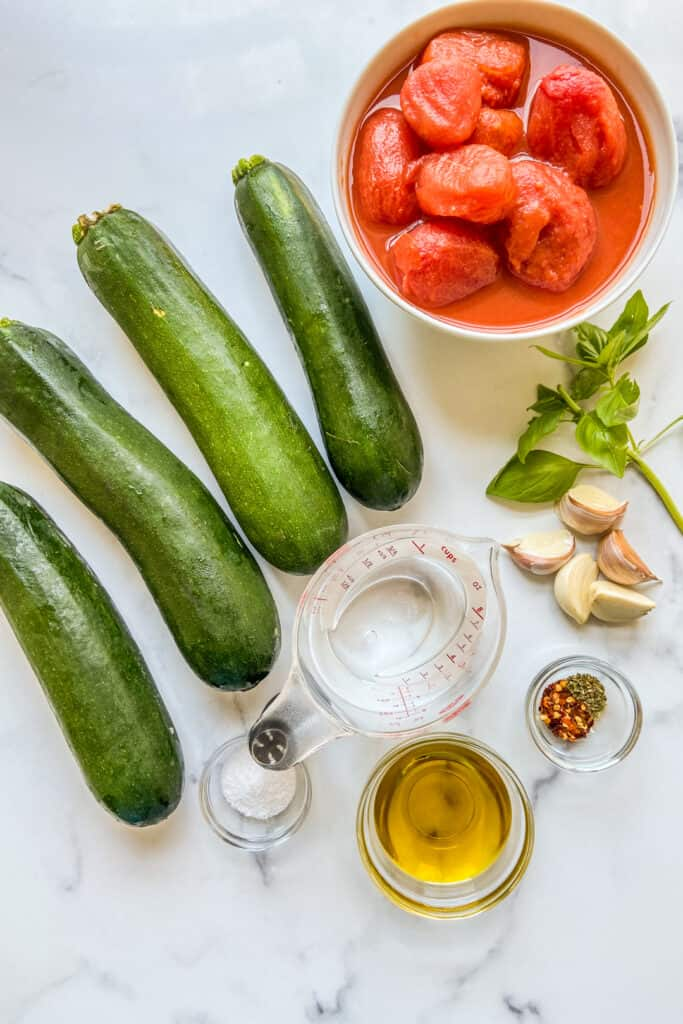 Ingredients for zucchini noodles and tomato sauce.