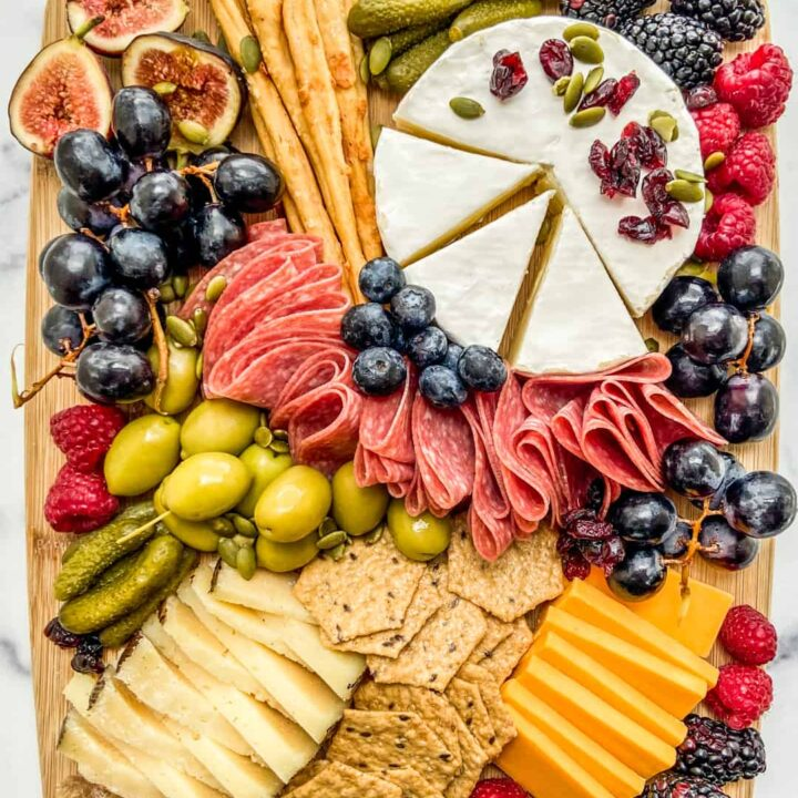 An overhead shot of a fall charcuterie board on a wooden board.