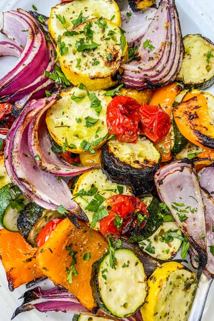 A closeup shot of a plate of Mediterranean grilled vegetables.