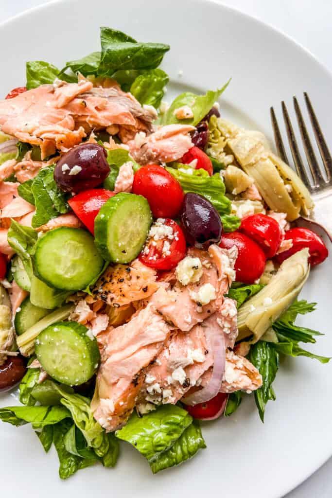 A closeup shot of Mediterranean salmon salad on a plate.