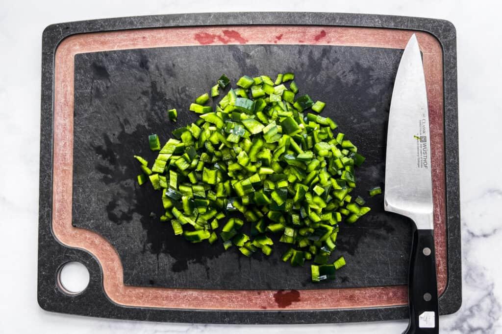 Chopped poblano pepper on a cutting board.