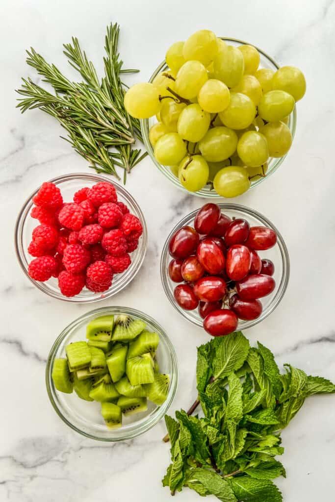 Grapes, fresh herbs, kiwi, and raspberries.