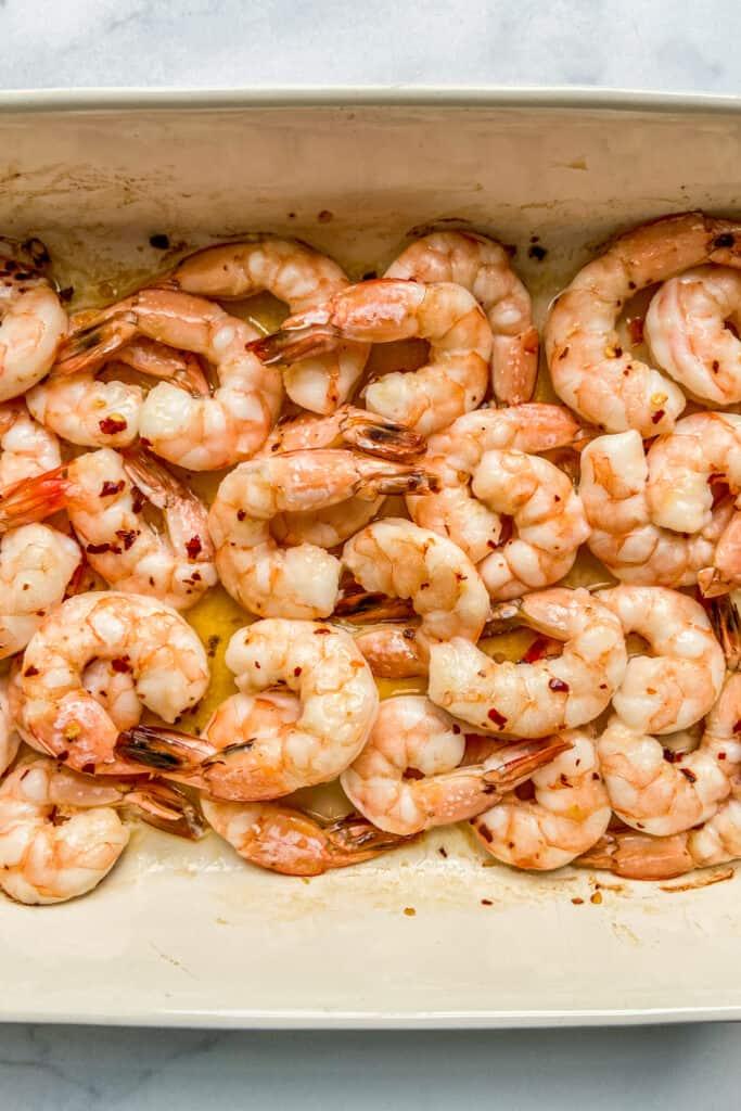 Baked shrimp in a baking dish.