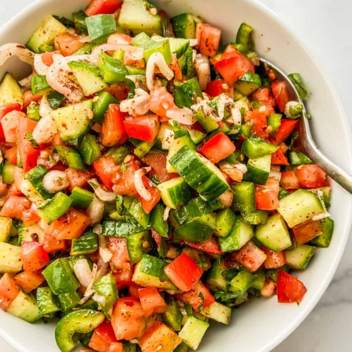 An overhead shot of a chopped Turkish salad in a white serving bowl.
